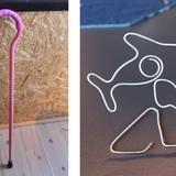 写真左が同社オリジナル製品の杖、右はイルカをかたどったオブジェです